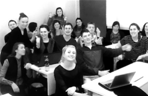 happy smiling TEFL students in a classroom