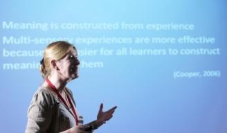 a woman giving a teaching development seminar