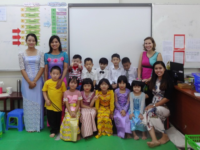 teaching English at a Montessori in Myanmar -KG graduation with some of our class, all dressed up in traditional Myanmar longyi